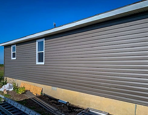 Installed siding on the house wall